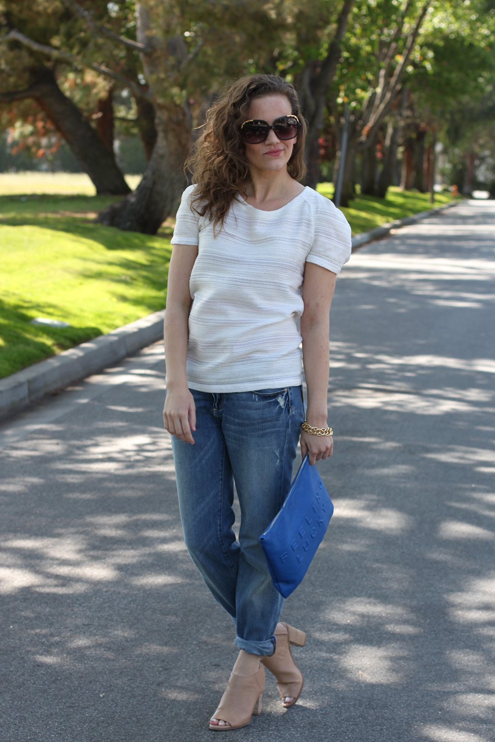 Easy casual look: structured top with distressed denim and booties on undeniable style san francisco blog.