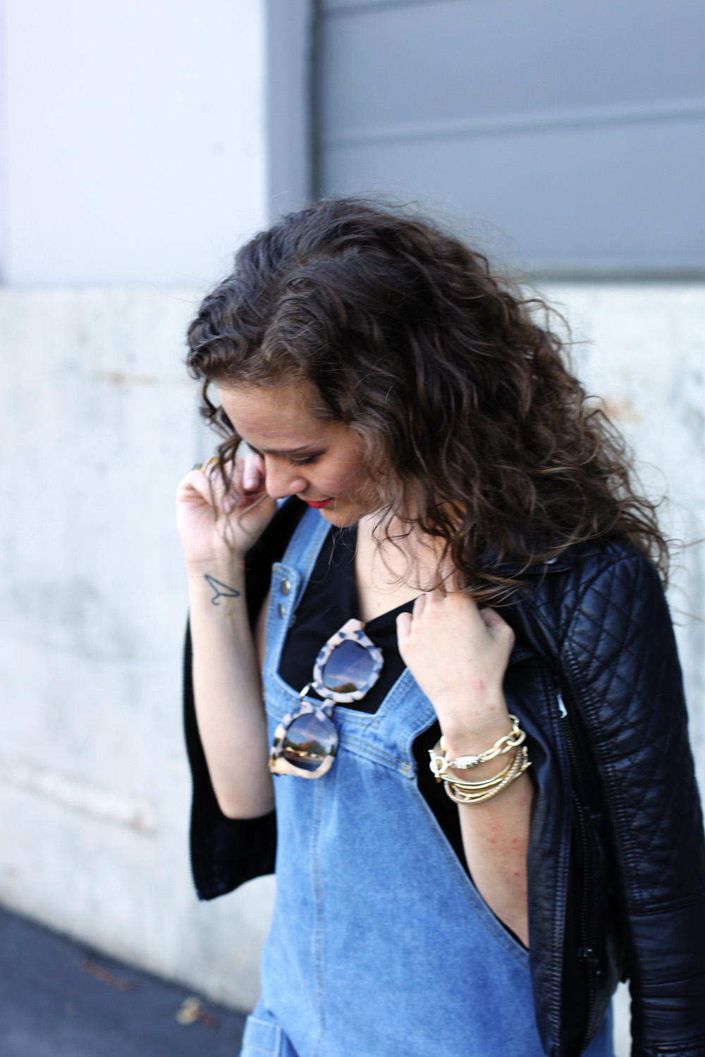 Short overalls and leather jacket on undeniablestyle.com