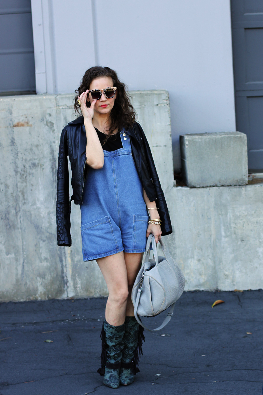 Transitioning short overalls to fall with leather and boots -- undeniablestyle.com
