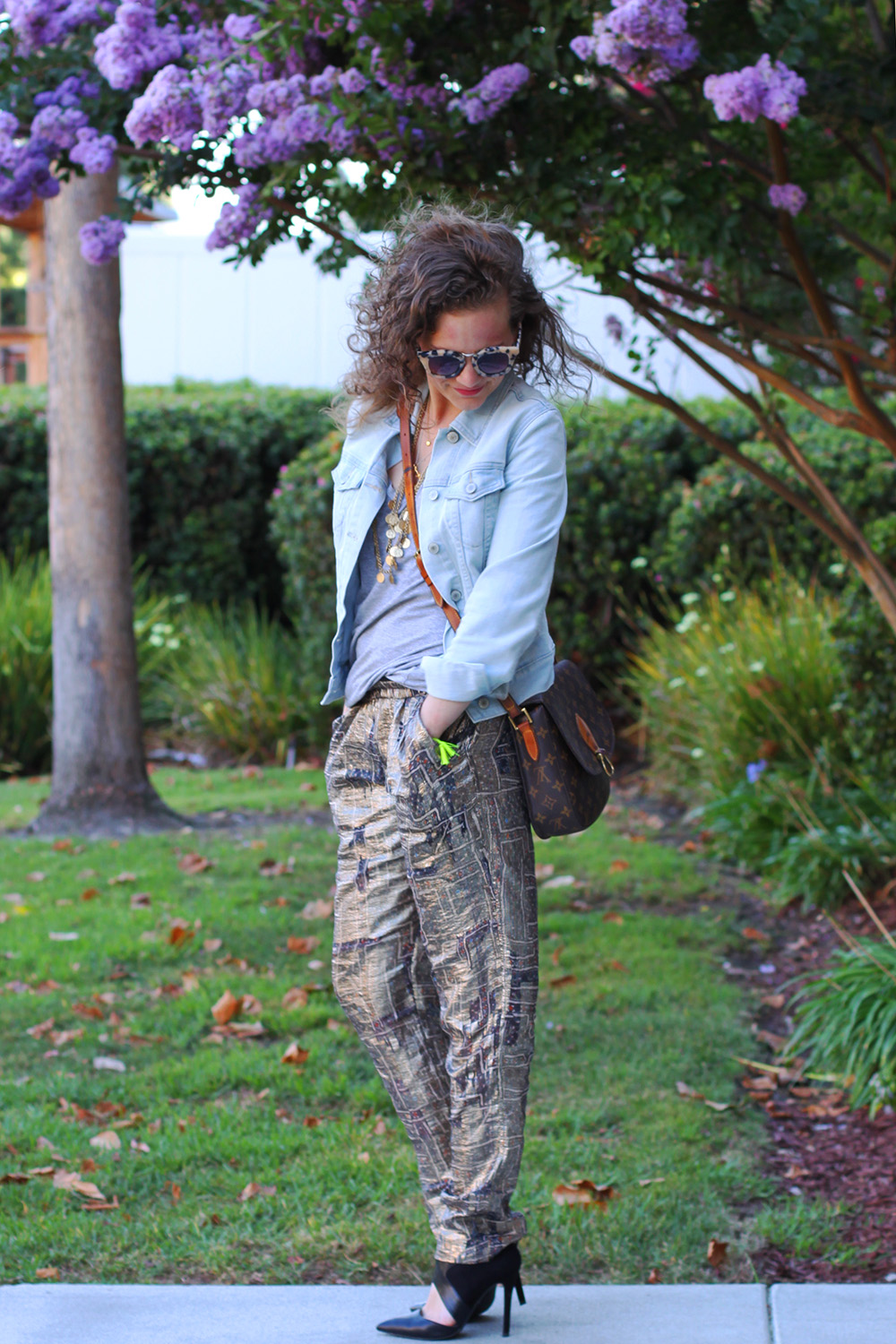 Isabel Marant pour HM gold lamé (gold lame) pants are casual cool when paired with denim and a tee on undeniablestyle.com